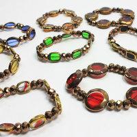 15 x  kupferfarbene Armbänder mit Glas- Metallperlen