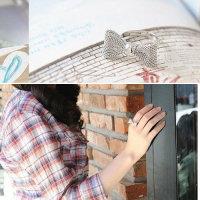 Ring mit Kopf in Schleifenform silber